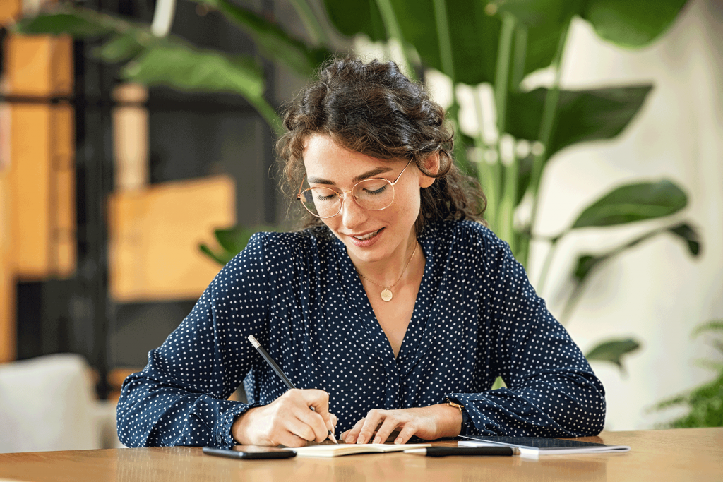 Young Entrepreneur writing down SMART Goals